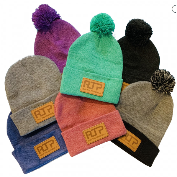 """Run the Peninsula 12"""" Knit Beanie (some with Pom-Pom) 100% acrylic 12"""" in length 3'' in cuff Pom-pom on top (of some of them)"""